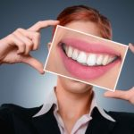dental insurance Woman showing teeth