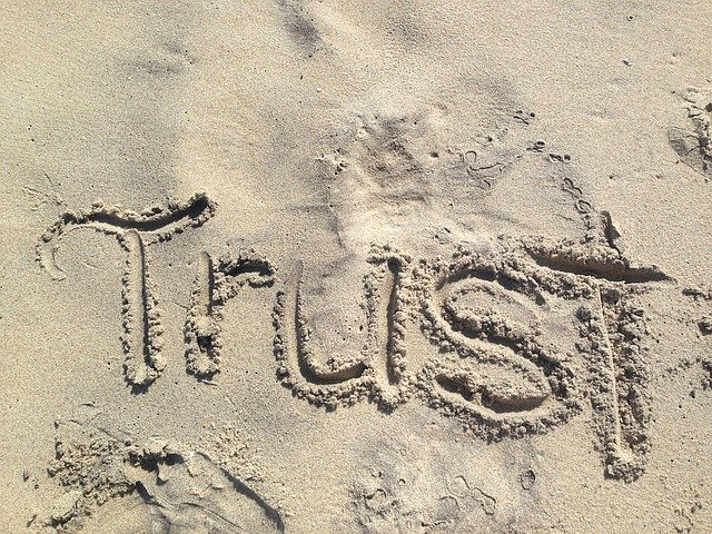 Florence Health Insurance Agent Trust written in sand