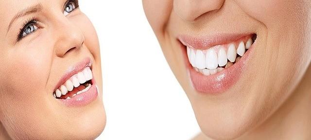 Woman focused on teeth