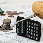 coins and potato balancing