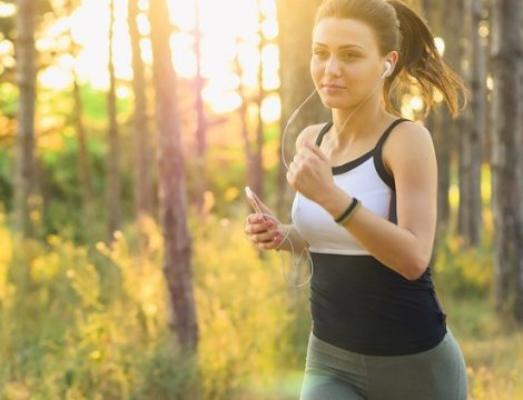 Lady Jogging in Park with Headphones shedding pounds